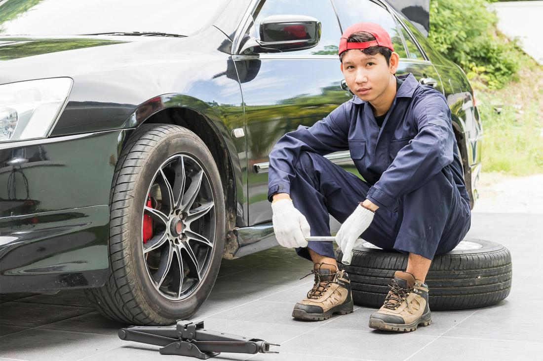 a young man changing his tire
